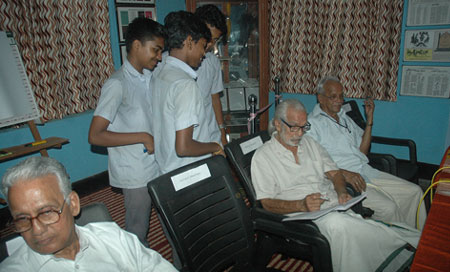 Students getting Artist Namboodiri's autograph