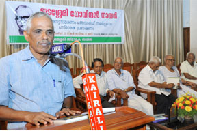 Dr. K.P. Mohanan introducing the book by Dr.M.R.Raghava Warriyar