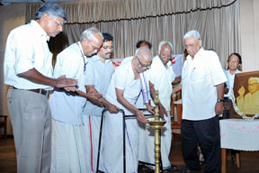Mahakavi Akkitham lighting the lamp to inaugurate the function.