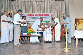 Mahakavi Akkitham presenting the Award to Dr. M.R. Raghava Warriyar